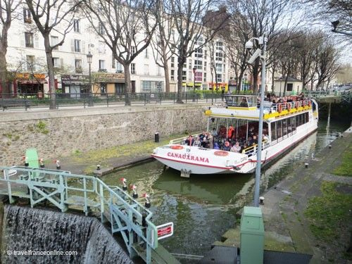 Boat passing a lock on Canal Saint Martin