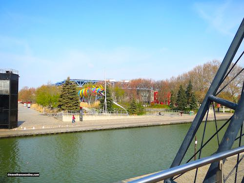 Children playground and Canal de l'Ourcq in Parc de la Villette