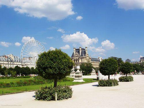Tuileries garden - Ferris wheel and Pavillon de Marsan in the Louvre