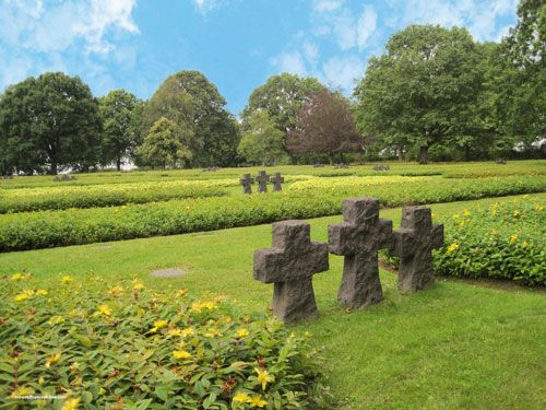 Marigny German Cemetery in La Chapelle en juger - Grey schist Crosses among St John's wort