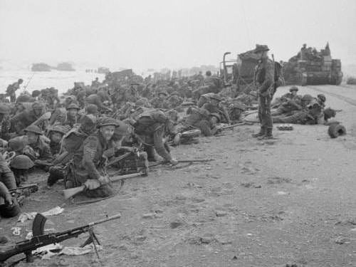 Troops crouching down on Sword Beach - Sword Beach