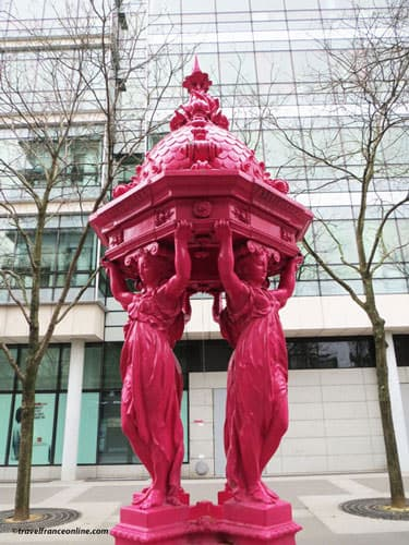 Wallace Fountains - Traditional fountain painted pink in the 13th district