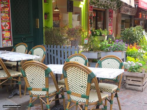A cafe terrace next to a fromagerie