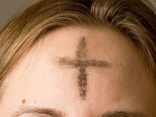 Cross of ashes on Palm Sunday
