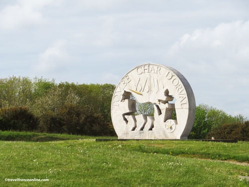Orval chariot burial monument on roundabout near Coutances