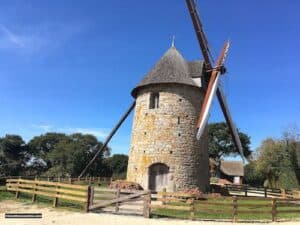 Cotentin Windmill and its barn in the background