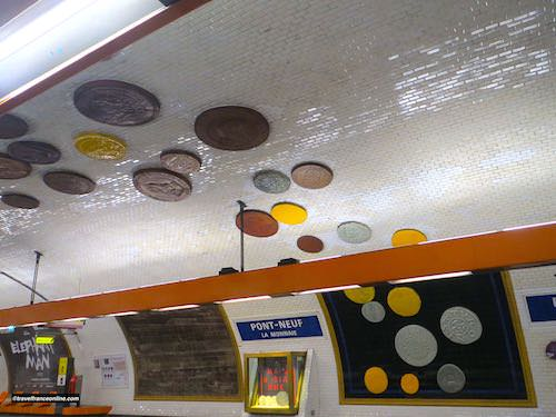 Oversized reproduction of ancient coins in Pont-Neuf Metro station