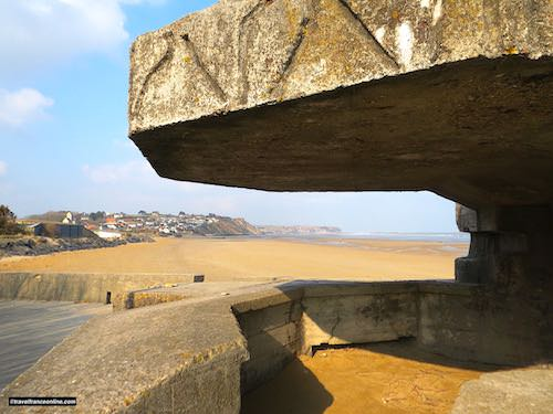 German bunker on Gold Beach and Arromanches in the background - Gold Beach War Memorials