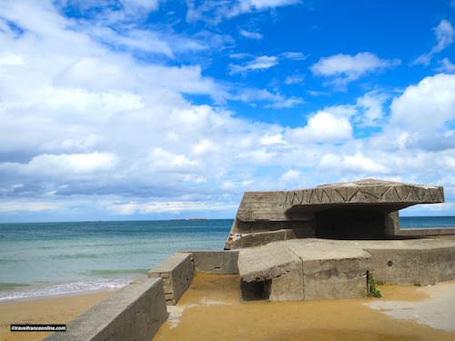 D-Day 75th Anniversary Commemorations - German bunker on Gold Beach with vestiges Mulberry Harbour